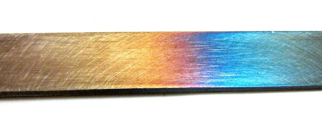 Different coloring on steel due to different tempering temperatures.
